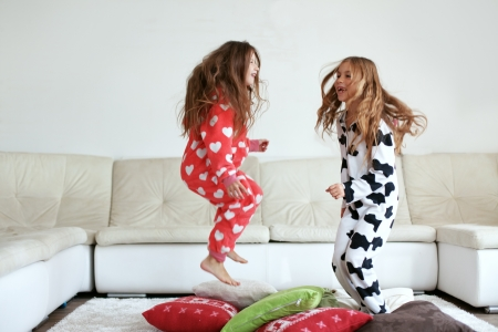 23963036 - children in soft warm pajamas playing at home